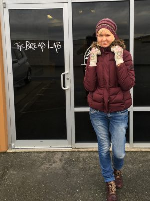 Laura Valli stands outside the door to The Bread Lab..