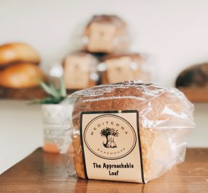 Bagged loaf of bread on wooden table