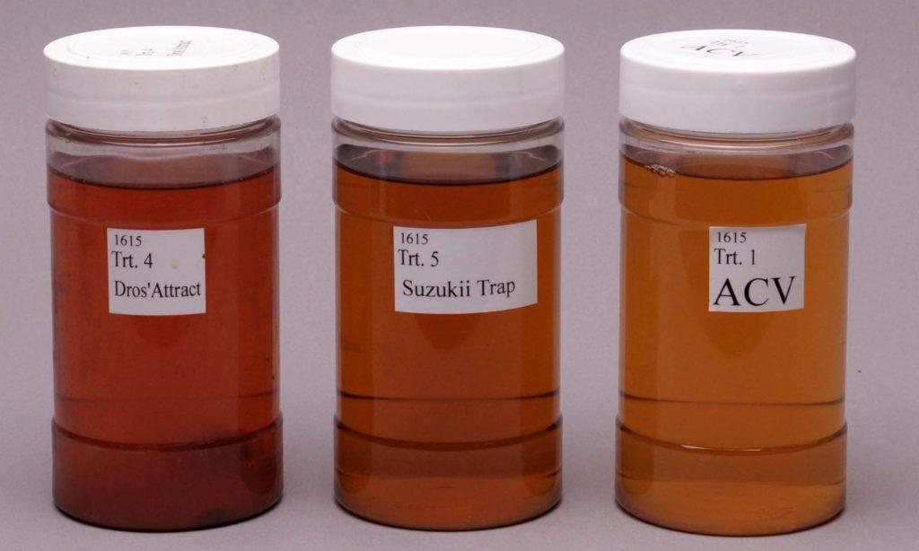 three small jars of amber liquids