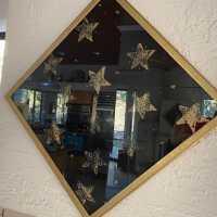Stars in gold diamond-shape frame