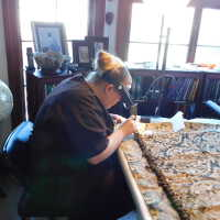 Kate sewing crepeline on drapery edge