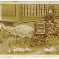 2020.176.001 Recto; Postcard of a young boy sitting in a goat cart