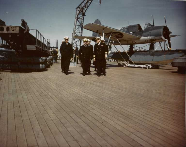 IOWA's CO Capt McCrea & officers on the stern next to a Kingfisher float plane on a dolly. cMay 1943 - 80-G-K-6118 picture number 1