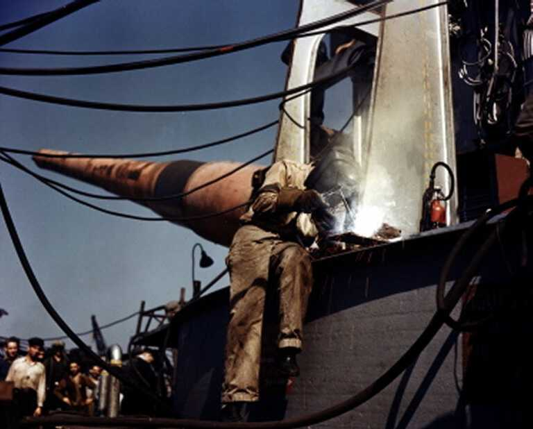 A welder constructs the face of one of IOWA's 16 inch gun turrets. October 1942 - 80-G-K-509 also 80-G-K-512 picture number 1