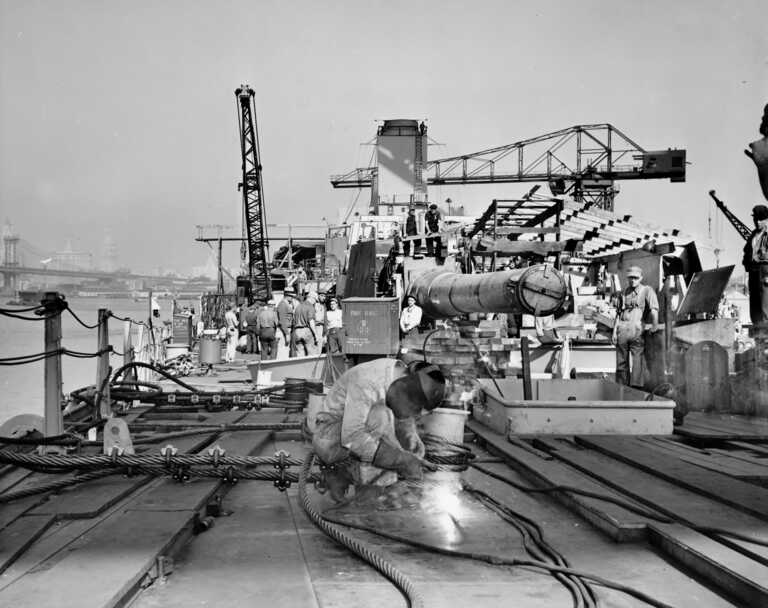 Welding on Forward Main Deck. 16 inch gun Turret 1 & superstructure begins to take shape further aft. October 1942 - 80-G-K-510 picture number 1