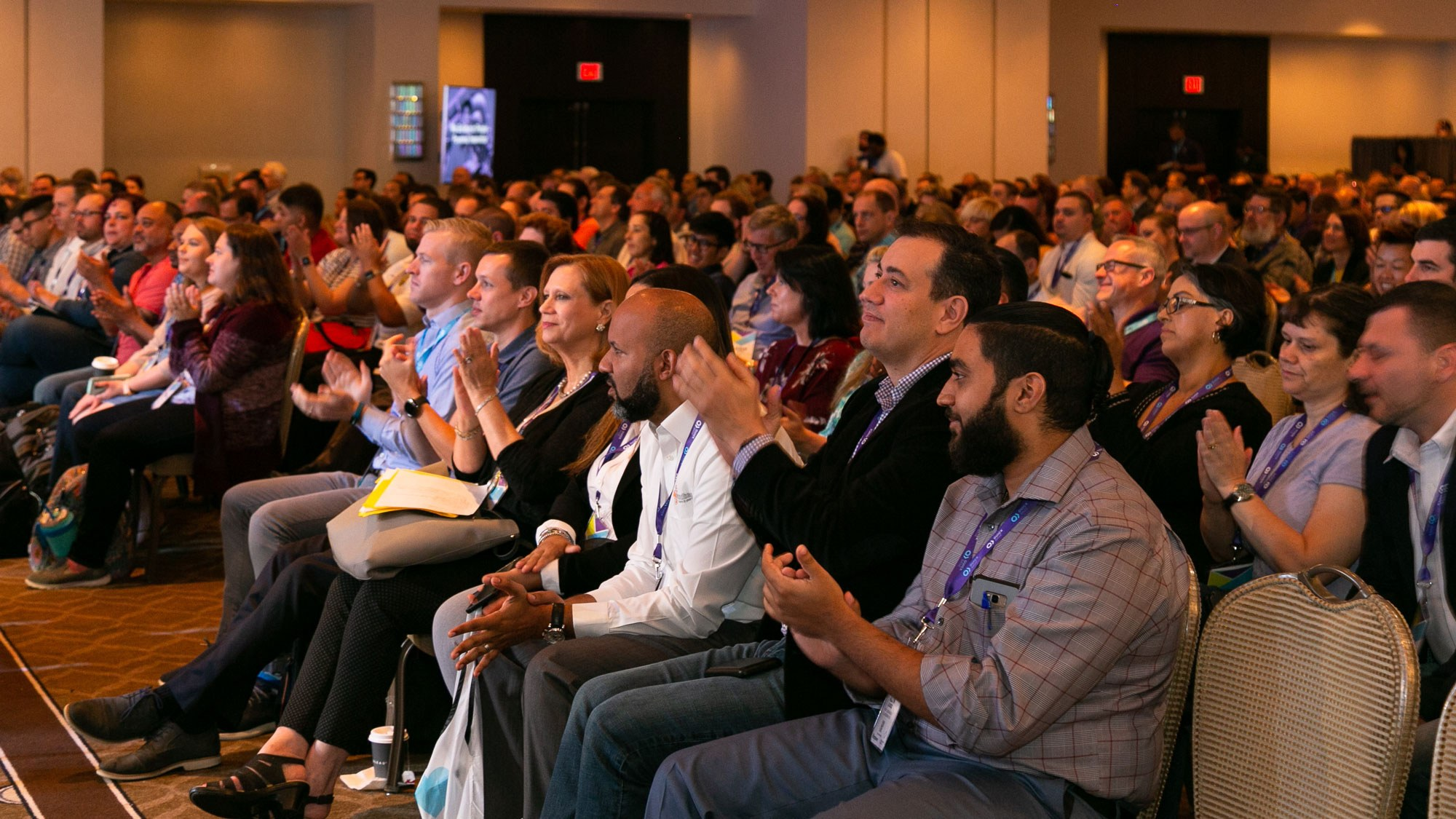 An audience applauds a presentation.
