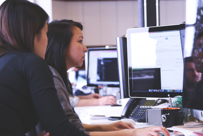 People collaborating to develop a low-code app