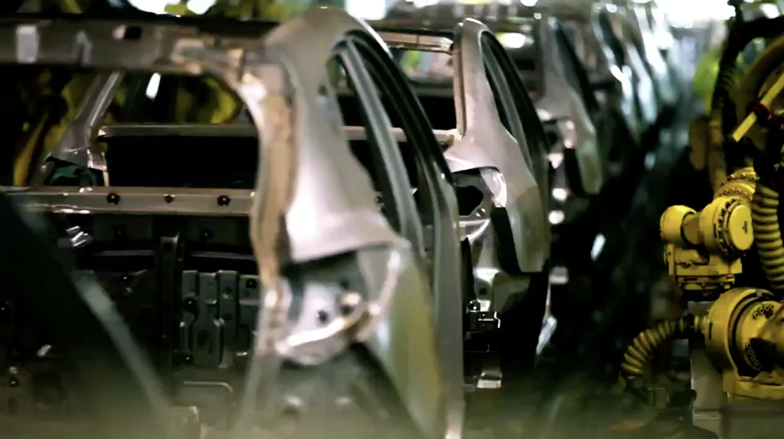 Car manufacturing plant machines working