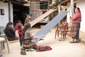Guatemalan-women-and-children-of-the-weaving-cooperative-that-partners-with-the-root-collective-women-weaving