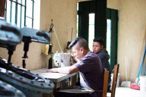 young-guatemalan-men-sewing