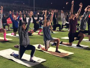 young-boys-doing-yoga-on-corc-yoga-mats-young-boys-in-yoga-pose-doing-yoga-on-sports-field