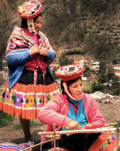 indigenous-women-wearing-ttraditional-garb-women-wearing-colorful-cultural-clothing-while-weaving