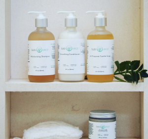 sudsource-products-displayed-on-shelf-sudsource-shampoos-and-conditioner-on-bathroom-shelf