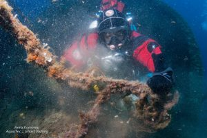 diver-collecting-samples-from-wreckage-site