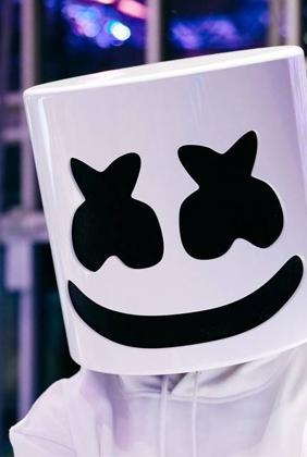 Marshmello dj wearing white hoodie in convention center