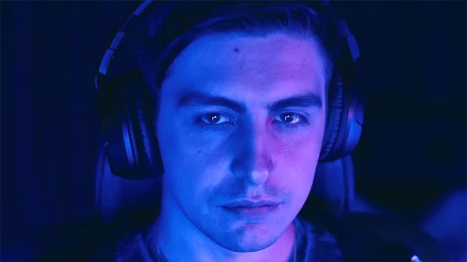Shroud gamer wearing headset in dark room with blue Mixer lighting