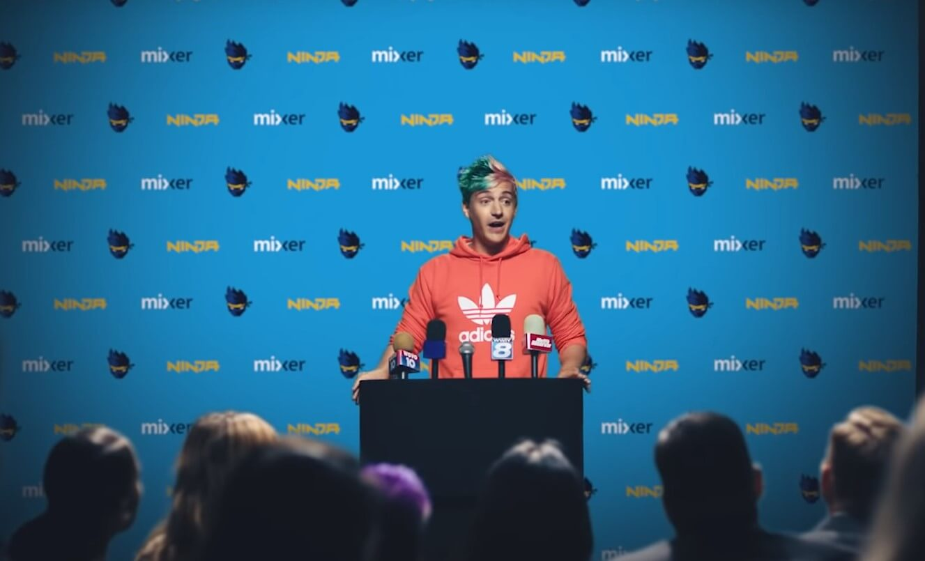 ninja gamer at podium press conference announcing mixer switch