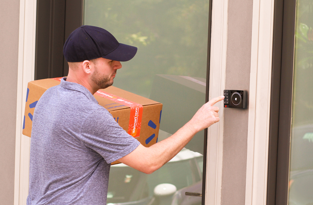Man using August lock for Walmart home delivery.