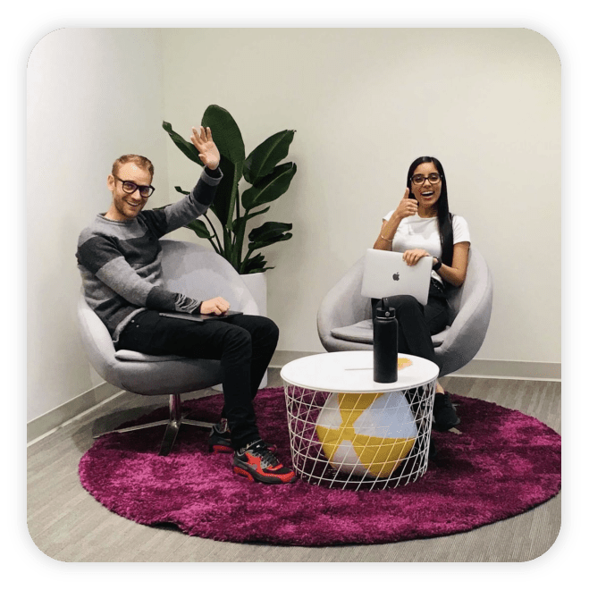 Two people sitting in the office