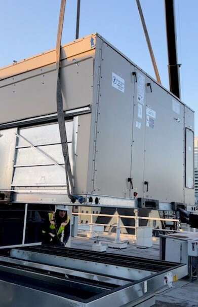 HVAC Unit being lowered into position on the EOC rooftop