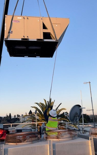 HVAC Unit on Crane being lowered onto EOC rooftop
