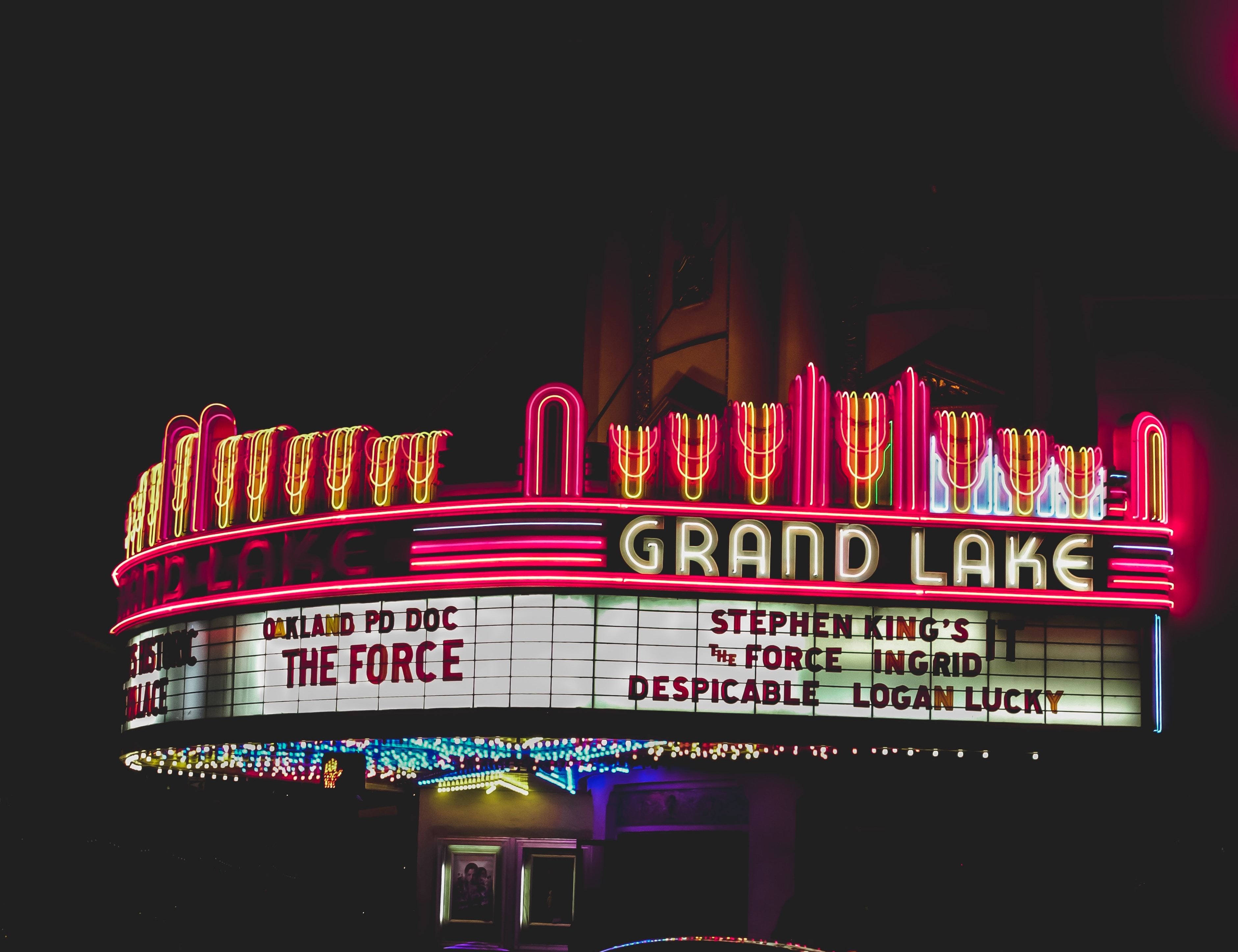 Nighttime photo of the Grand Lake Cinema marquee