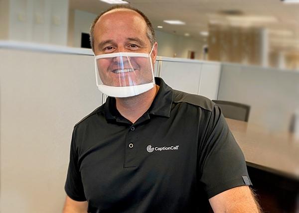 Man wearing clear mask