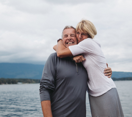Couple hugging by lake testimonials image