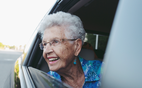 Elderly woman riding in car testimonials image