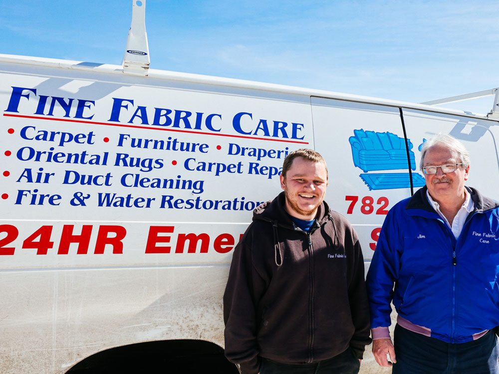 fine fabric care owner and staff infront of company vehicle