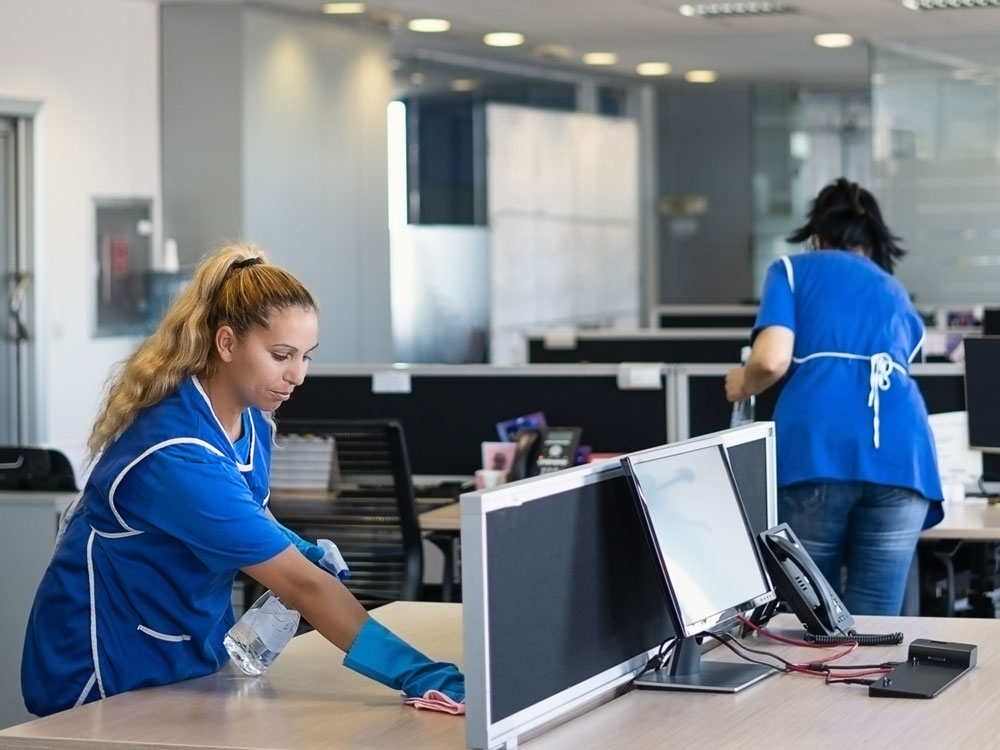 women deep cleaning office space