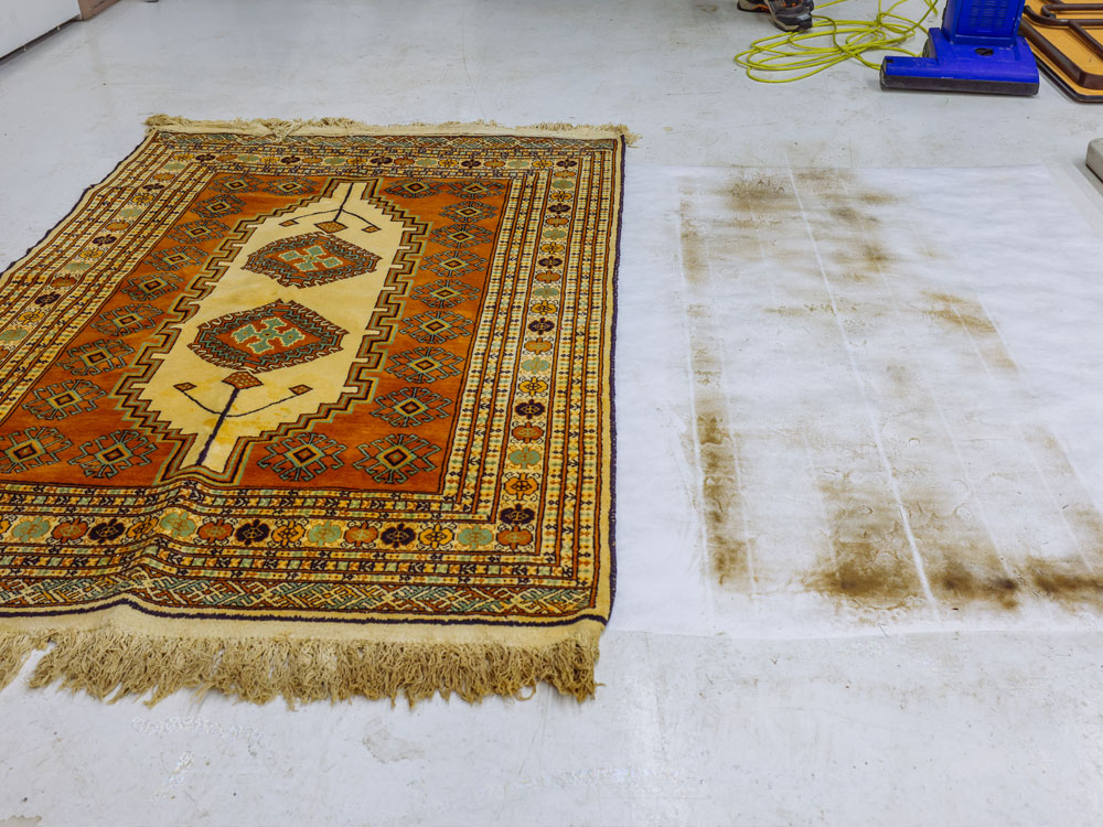 showing dirt extracted from area rug cleaning