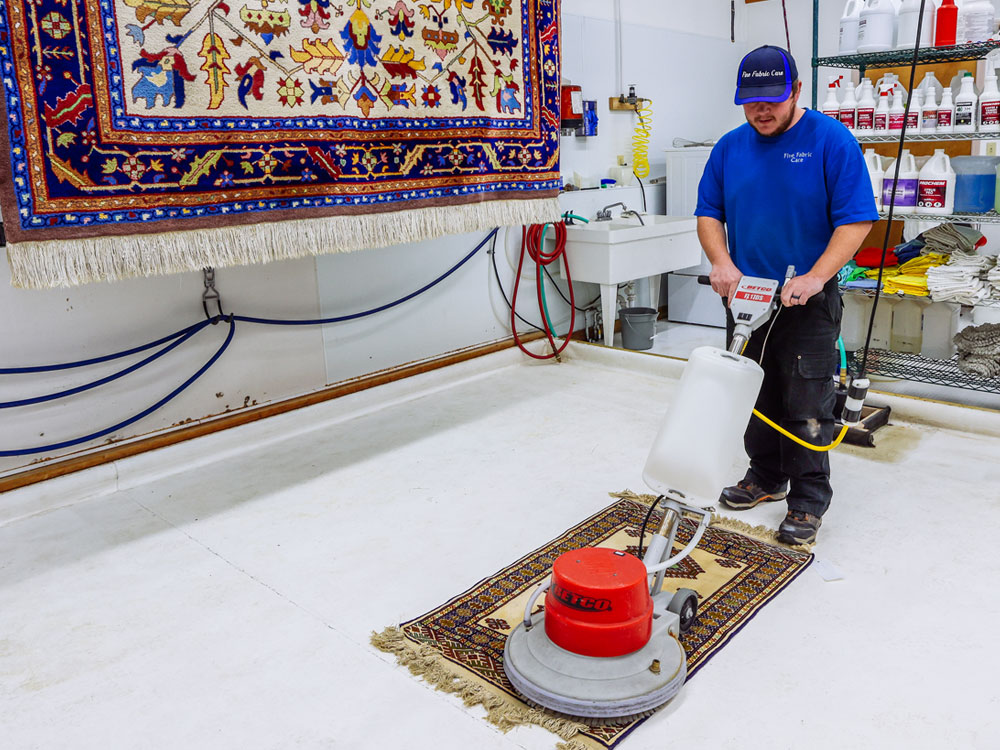 fine fabric care employee performing power clean as part of carpet cleaning service