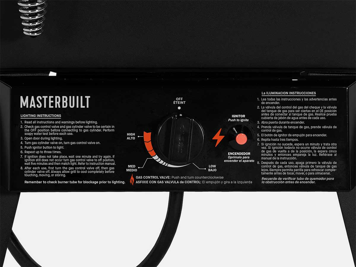 Push button igniter and temperature dial are conveniently located at the bottom of the smoker