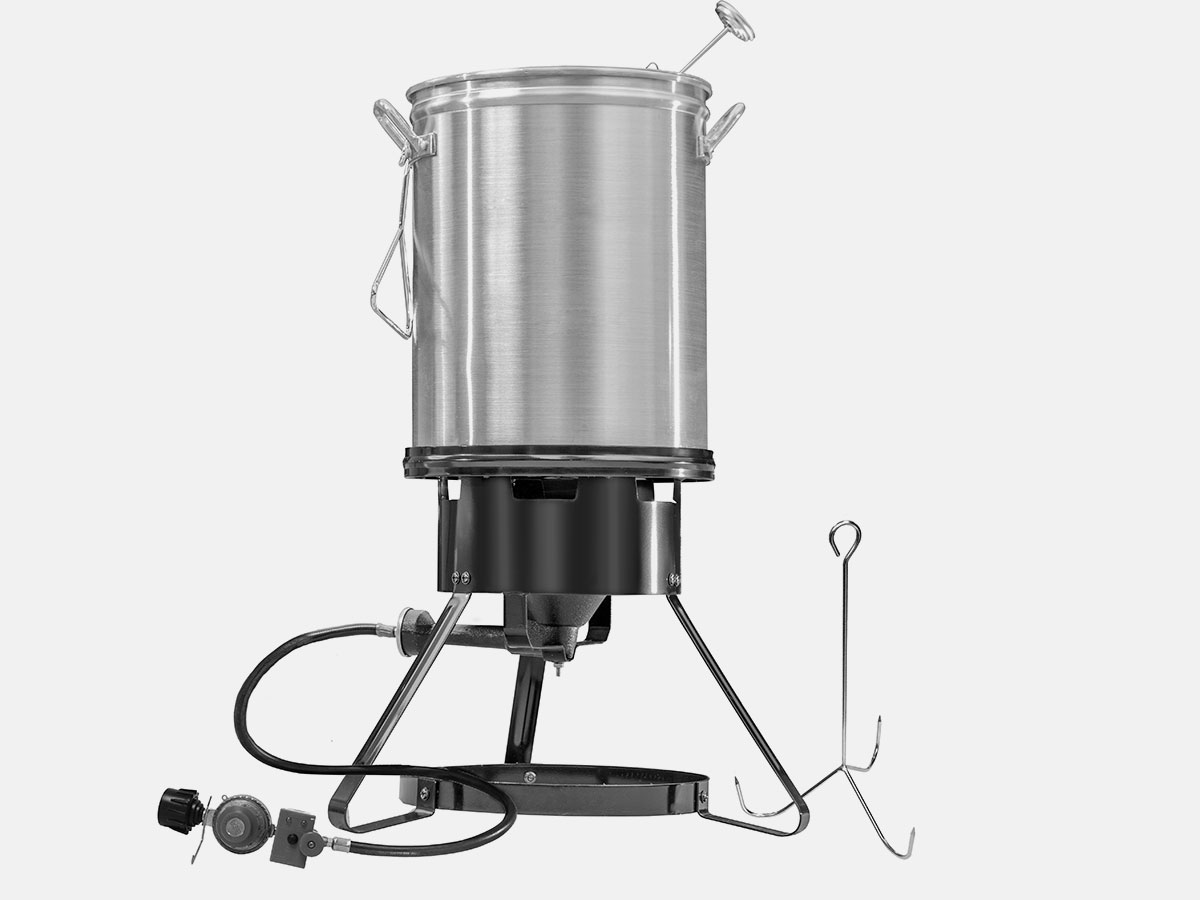 Lifting hook and poultry stand make removing food from the pot easy