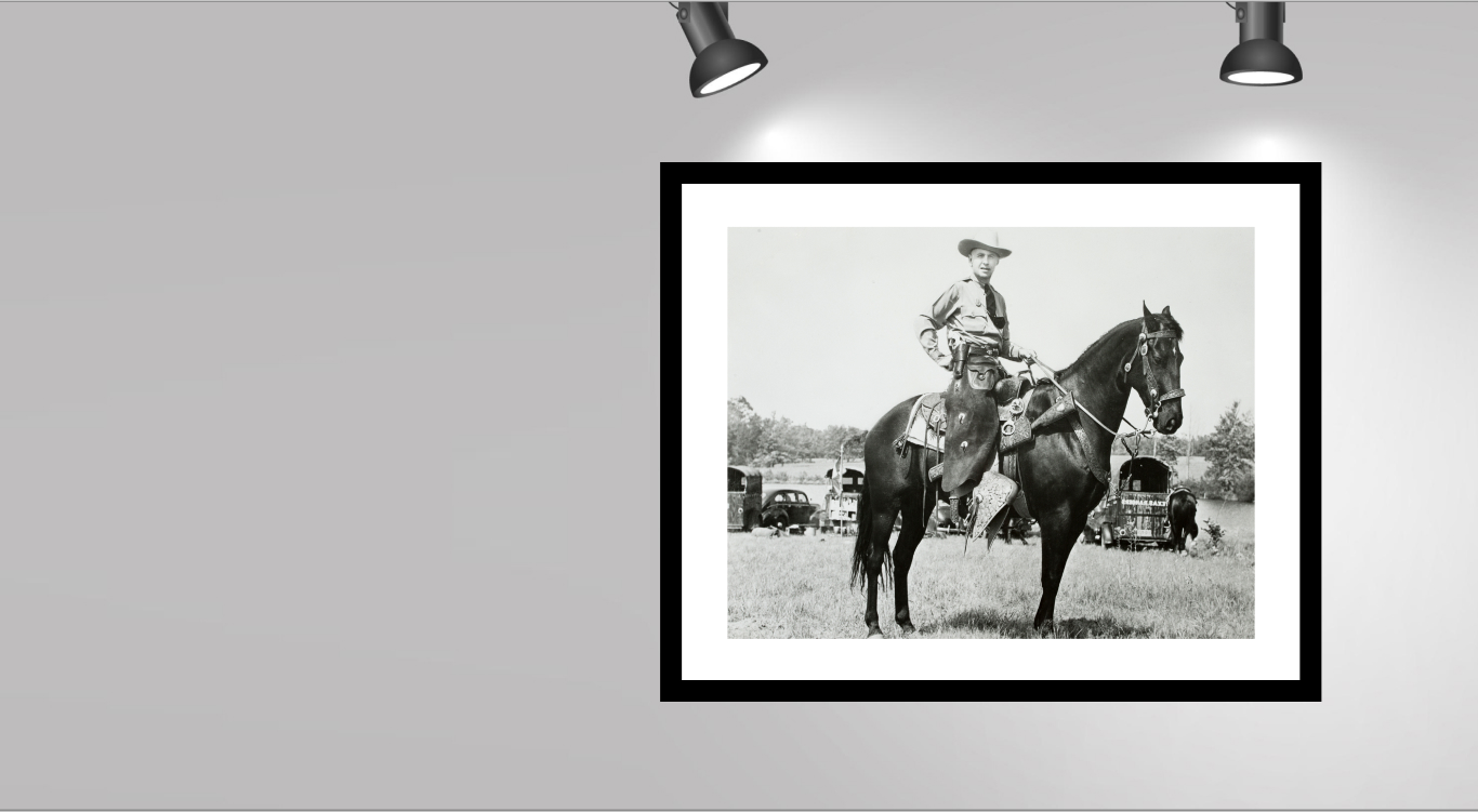 Texas Ranger smiling on a horse