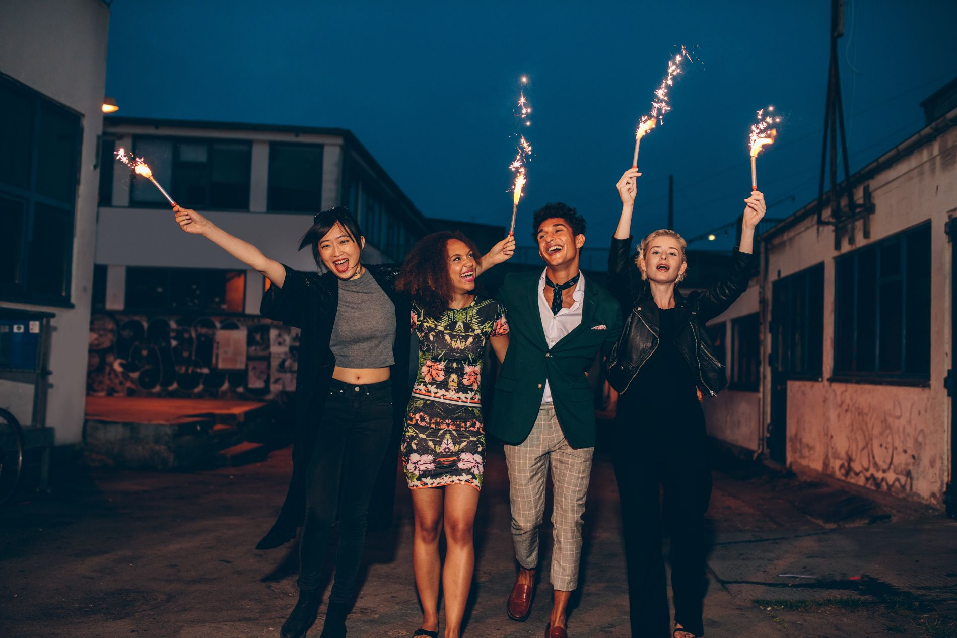 friends-enjoying-nighttime-party-with-sparklers-in-PMLENXC.jpg