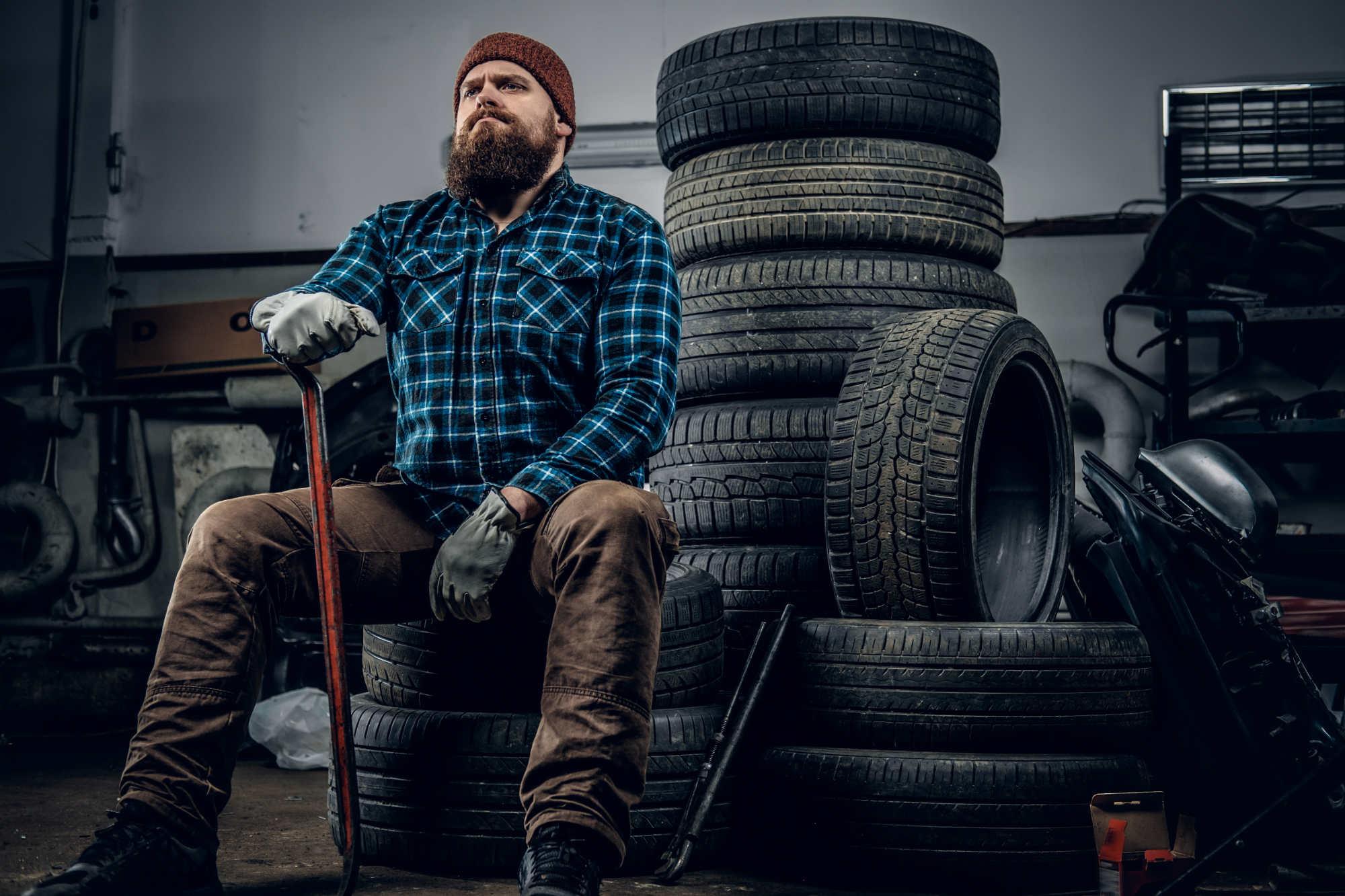 a-man-in-a-garage-ALKZNE6.jpg