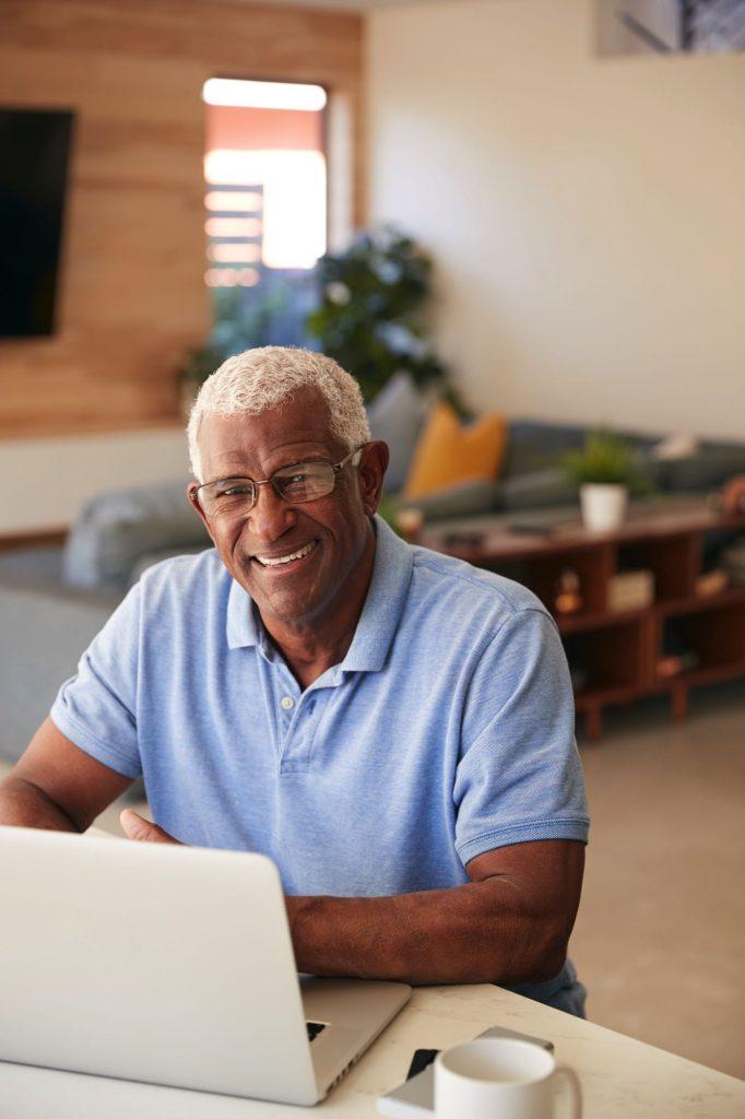 portrait-of-senior-african-american-man-using-lapt-T45PUPA.jpg