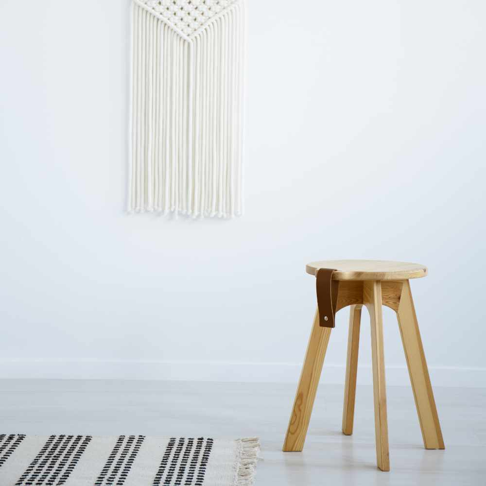 wooden-stool-and-rug-in-white-simple-living-room-i-63GYQD4.jpg
