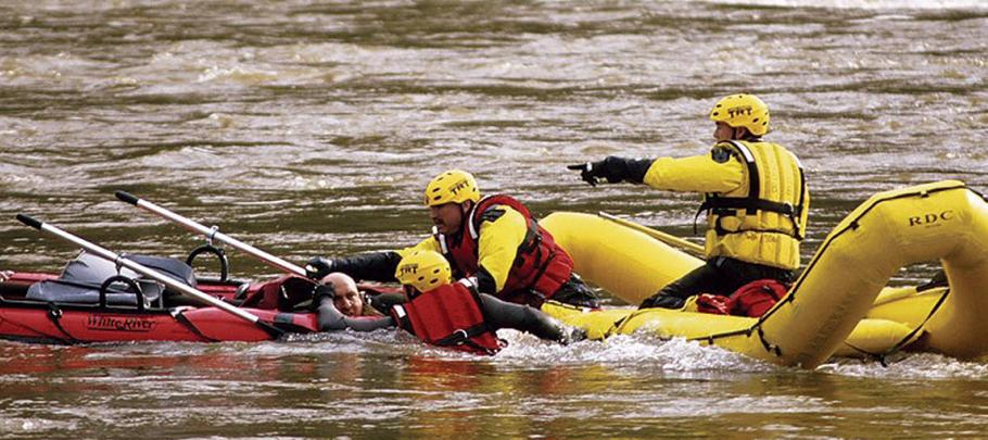 Rescue team saving man in water
