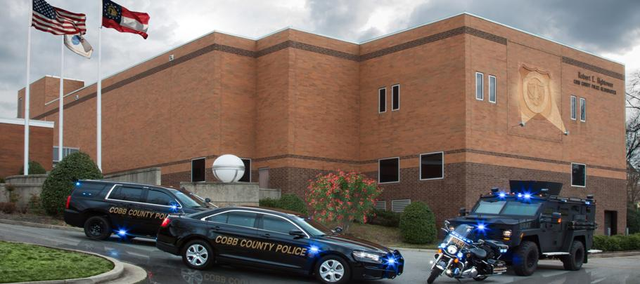 Cobb Police Headquarters with police vehicles