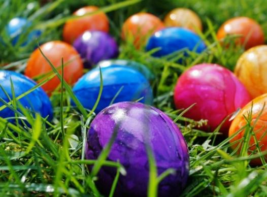 Photo of colorful easter eggs in grass.