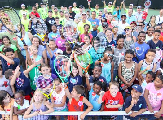 Photo of a large group of tennis players.