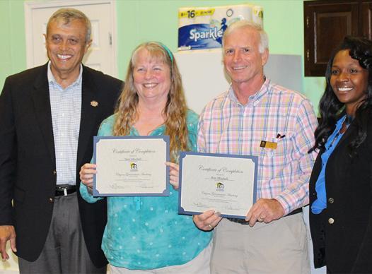 Cobb 101 graduates holding certificate