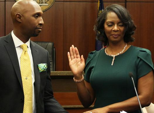 Joyette Holmes takes the oath