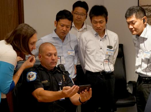 picture of japanese contigent with Cobb police officer