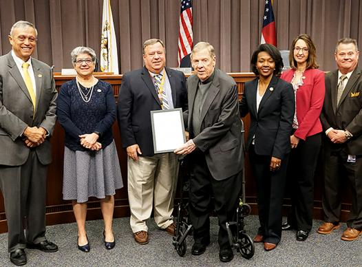 Sen. Isakson accepts proclamation from BOC