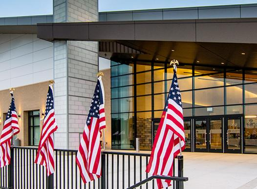 Photo of the Jim Miller Park Event Center with flags.