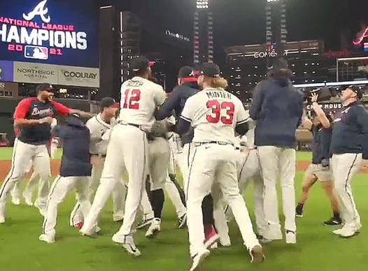 PICTURE OF BRAVES CELEBRATING NLCS WIN